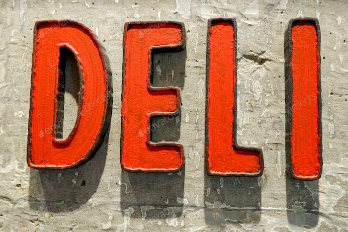 Deli. Delicatessen store sign on a concrete wall
