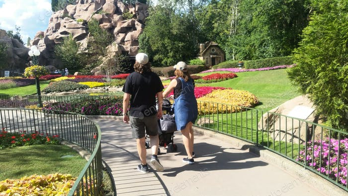 Natures beauty and moments in nature seen in Disneyland by strolling couple with child.
