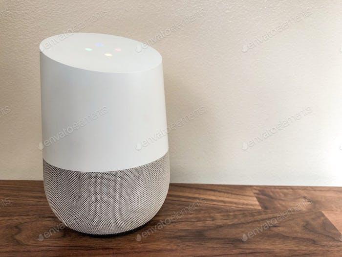 Google Home smart speaker on a wooden sideboard