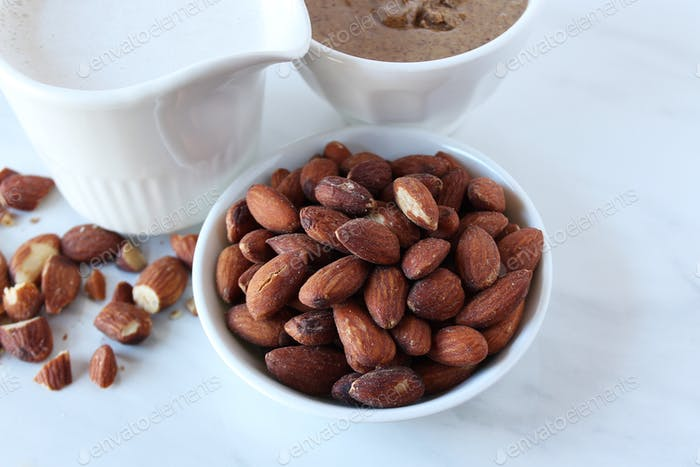 Almonds , almond butter and almond milk concept