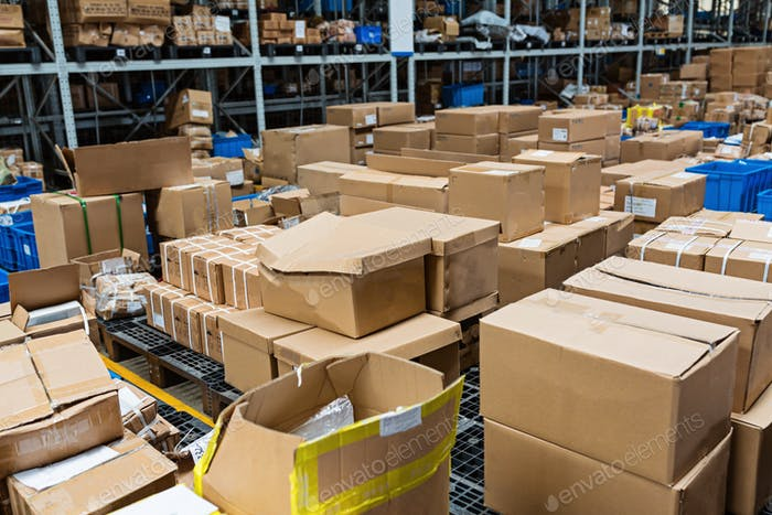 Boxes in warehouse. Goods packing, delivery service, storehouse