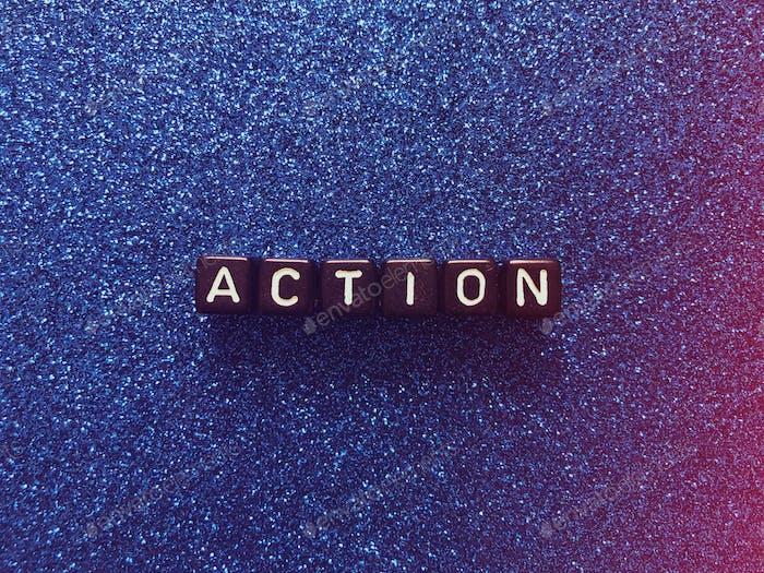 Action. Letter blocks. Alphabet blocks.