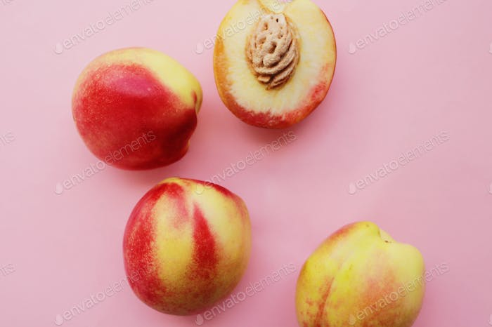Nectarines on a pink background