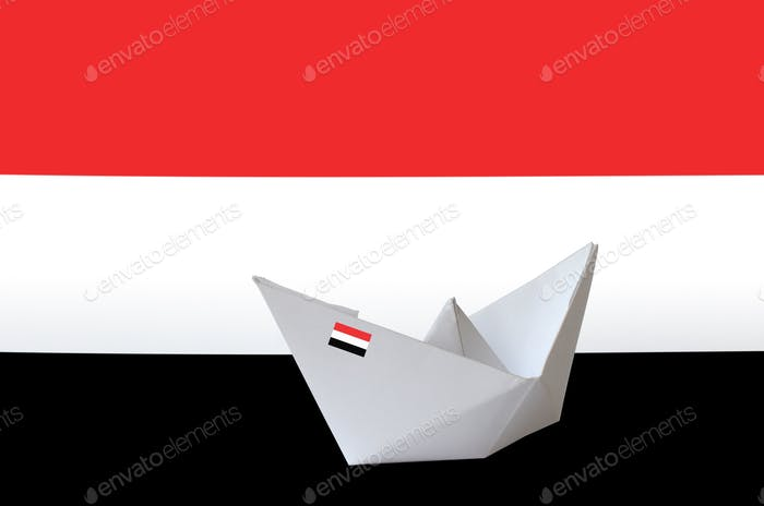 Yemen flag depicted on paper origami ship closeup. Oriental handmade arts concept