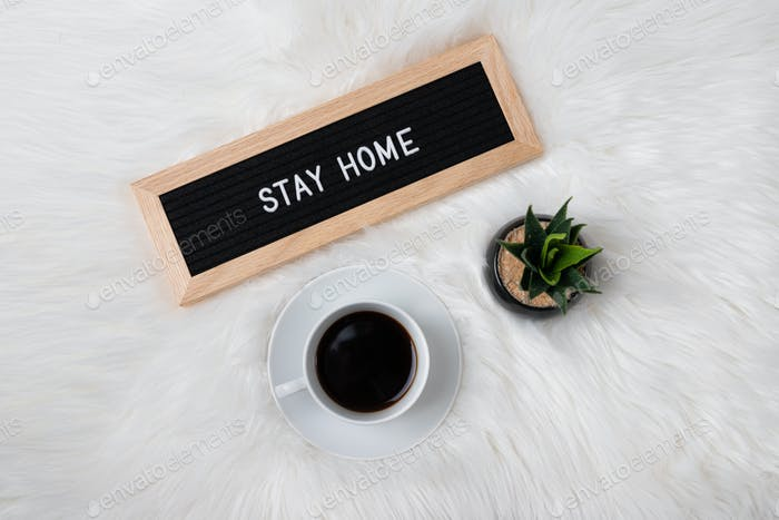 Overhead Flatlay of sign that reads Stay Home