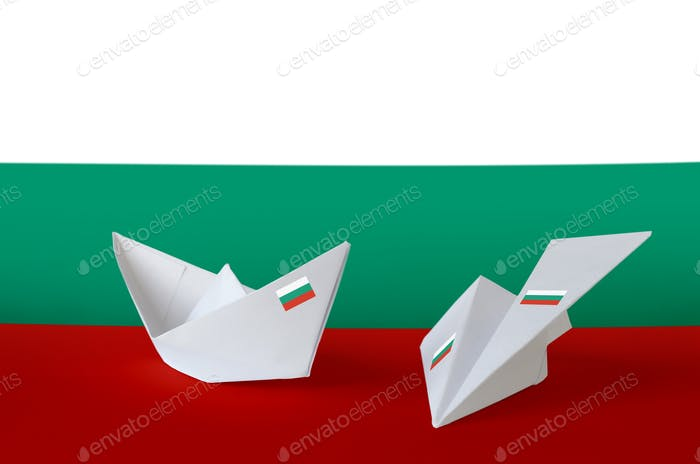 Bulgaria flag depicted on paper origami airplane and boat. Oriental handmade arts concept