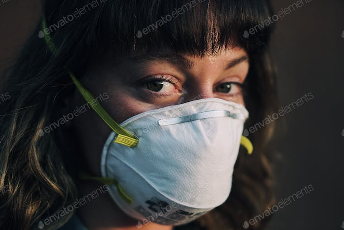 Woman with N95 face mask on