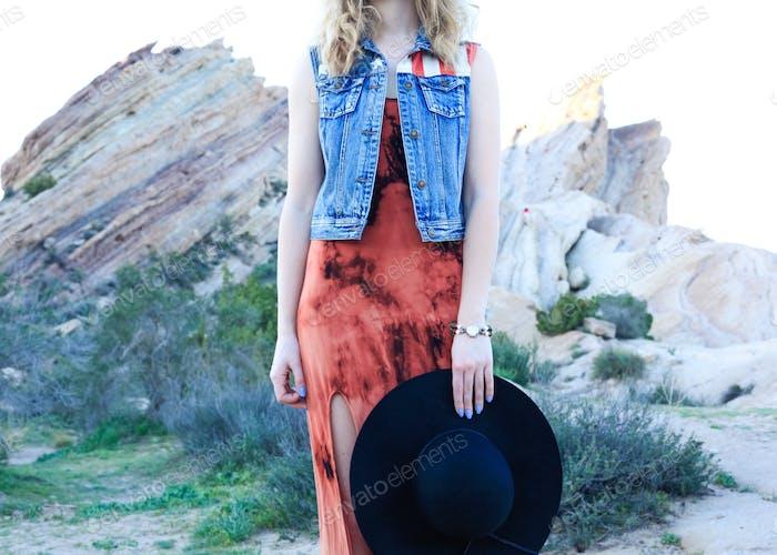 All American boho girl in the desert with denim