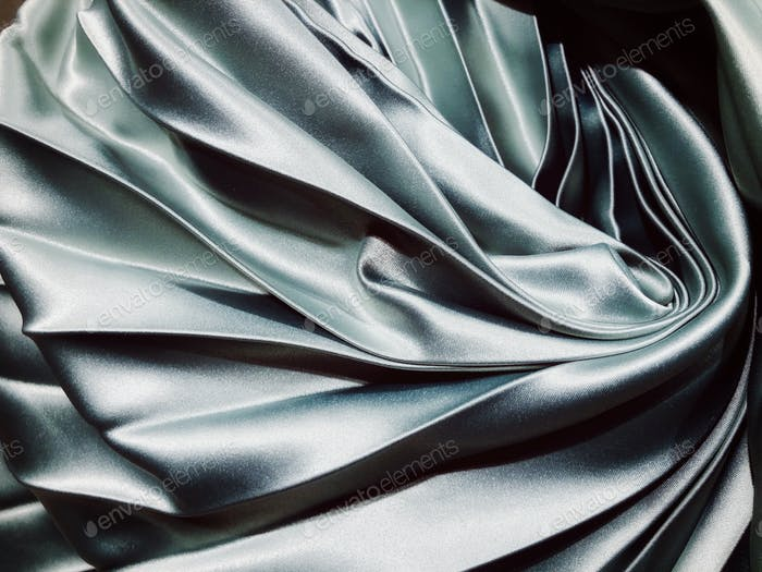 Silvery smooth satin fabric