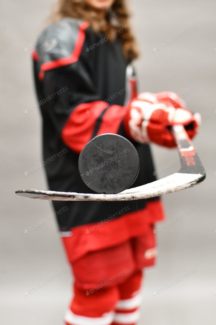 Hockey Player balancing a puck on her stick