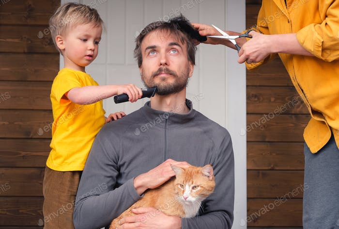 Family haircut at home during quarantine lockdown, domestic hairdressers