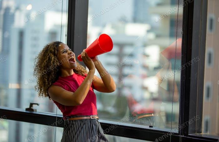 Women shouting on megaphone