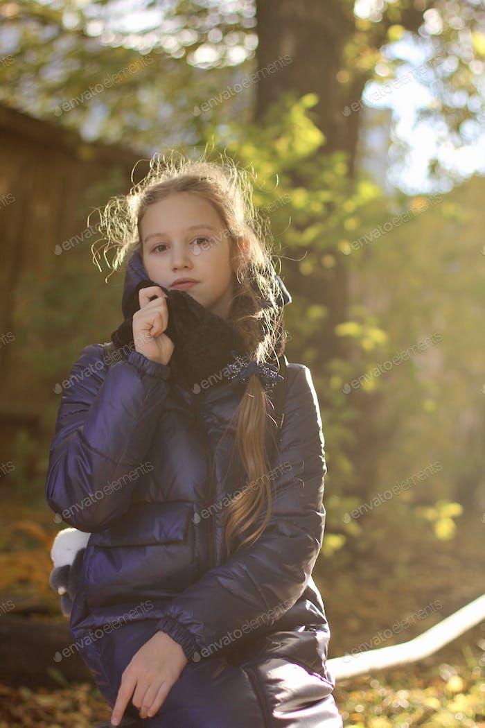 Portrait of beautiful teenage girl. Autumn mood. Sunlight.