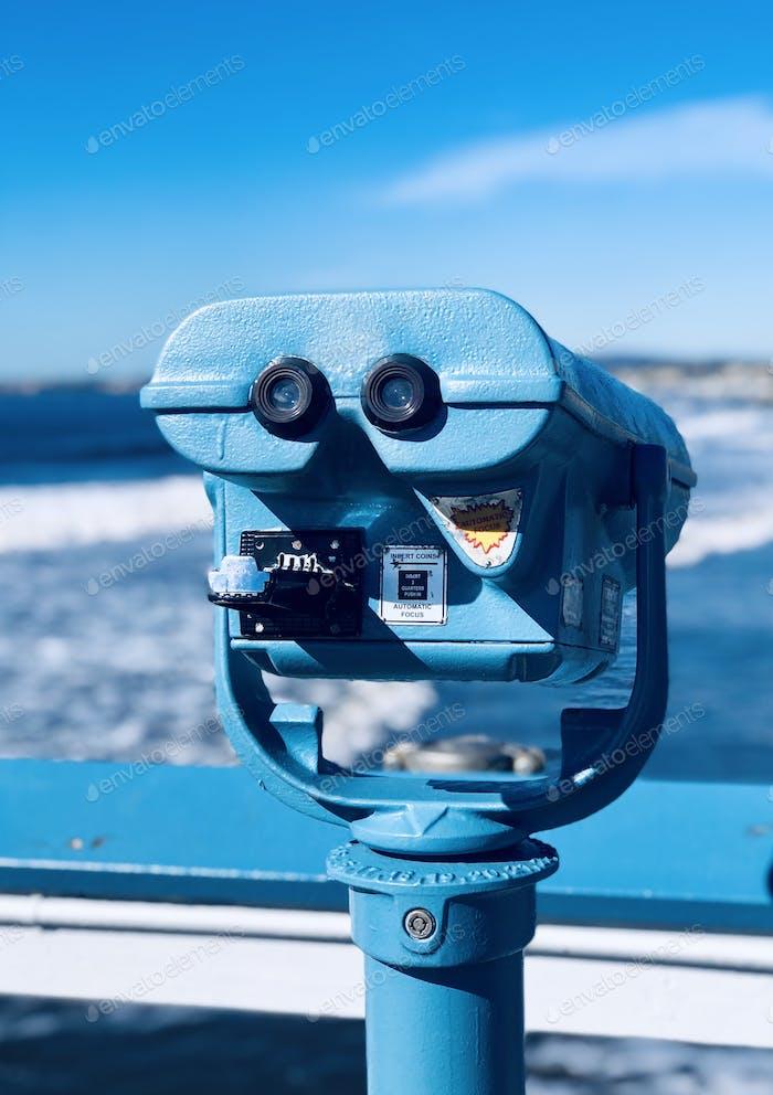 Blue telescope against blue sky
