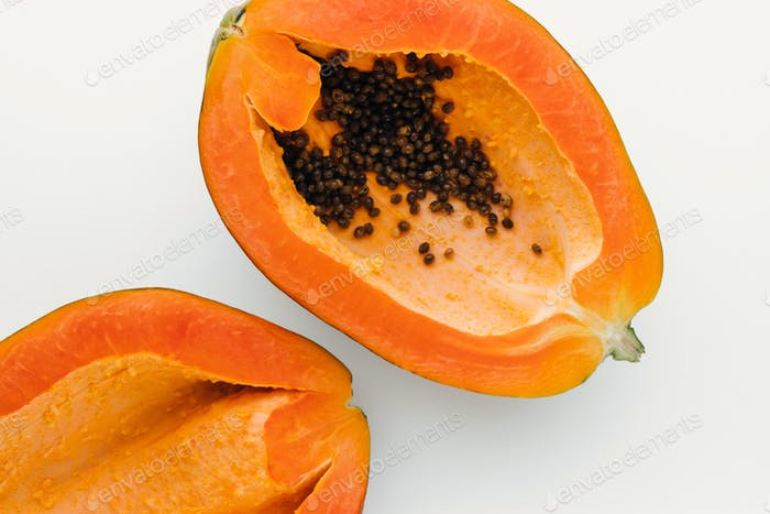 Papaya on a white background with clipping path, creative food concept, tropical fruit flat lay