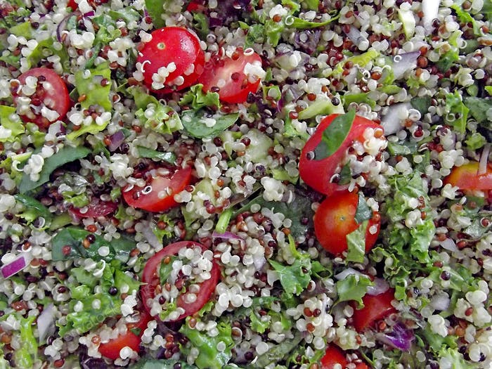 Quinoa salad with kale, parsley, Spanish onion, baby spinach & cherry tomatoes