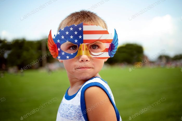 Little boy with an American Eagle glasses celebrating July 4th
