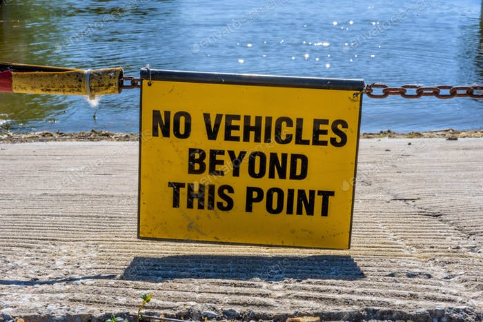 Warning sign that says No vehicles beyond this point