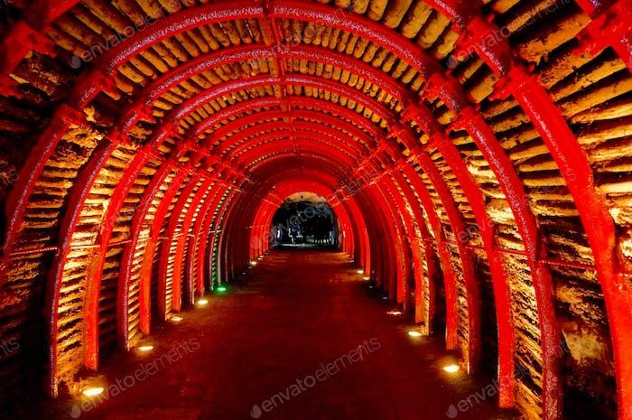 Red illuminated underground tunnel.