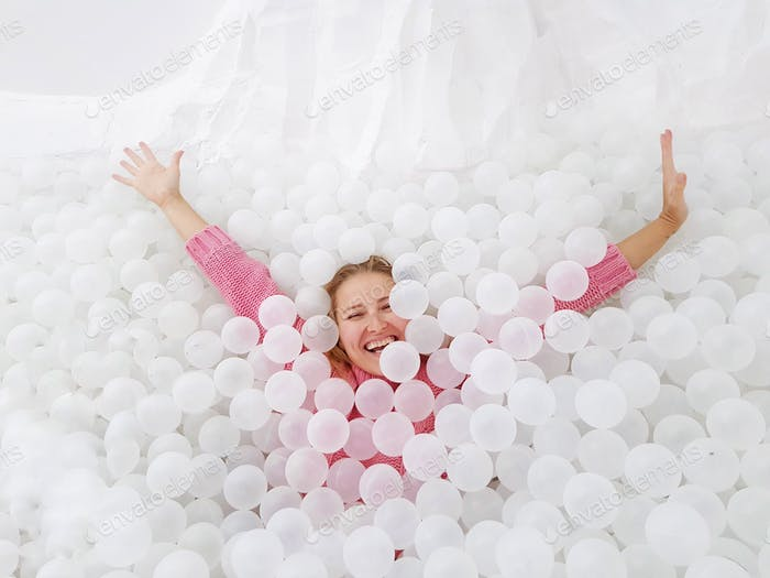 Woman in the ball pit