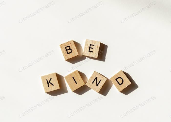 Be Kind letter tiles on white