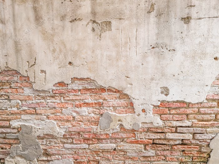 Old brick wall in antiquity and was damaged by the time until the mortar fell. - Image