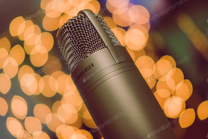 Condenser microphone against festive Christmas lights