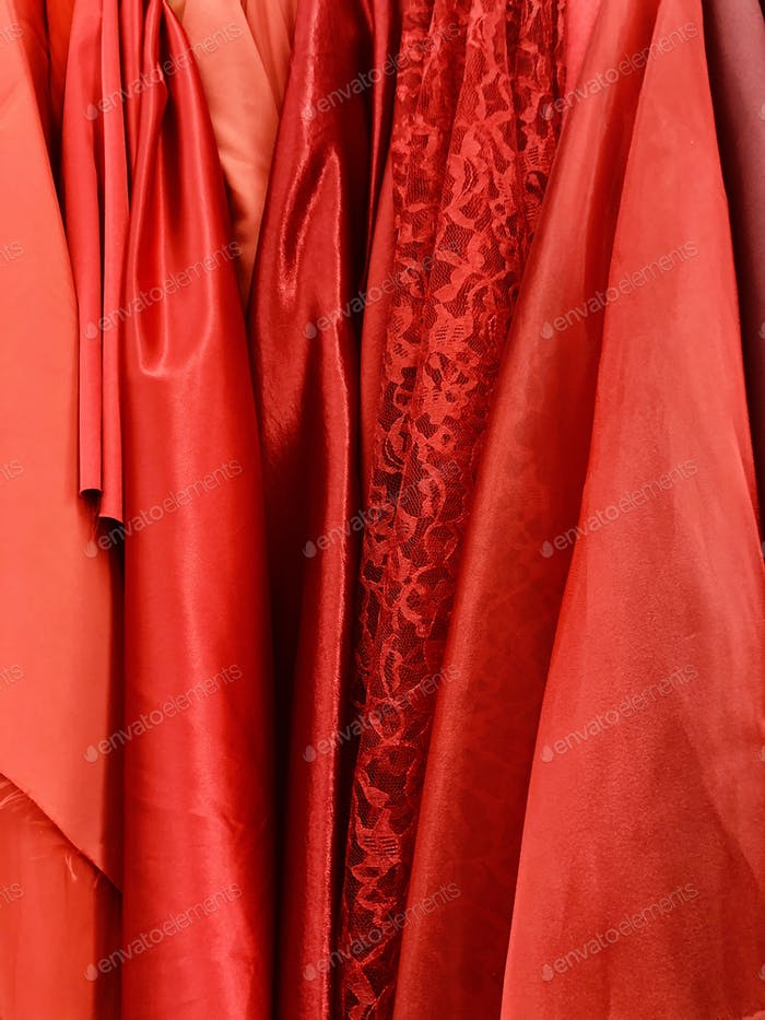 Satin lace fabrics in different shades of red.