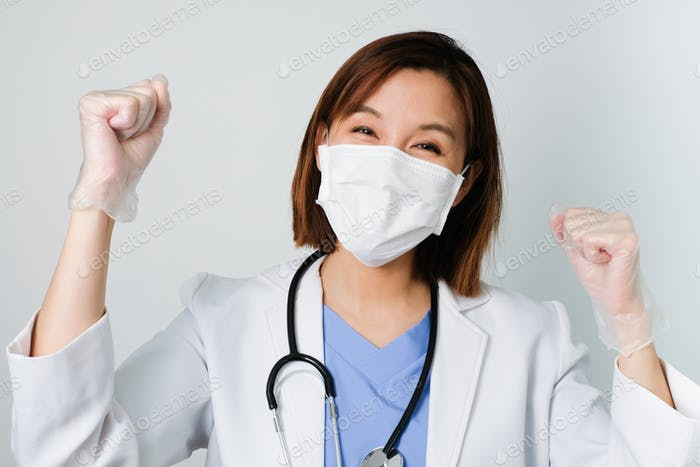 doctor working, smile, wear the medical mask to protect and fight infection