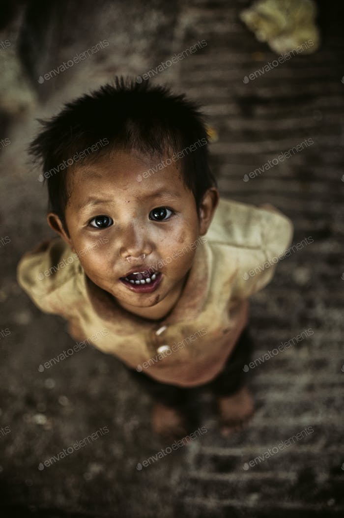 poor young nepal travel india child baby boy smile portraits