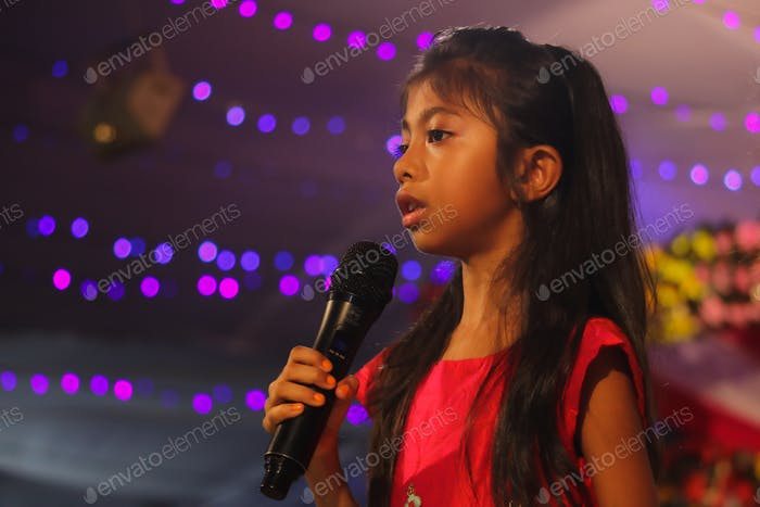 Girl child performing