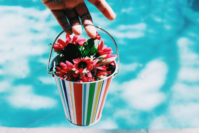 Colorful flower basket in pale blue background