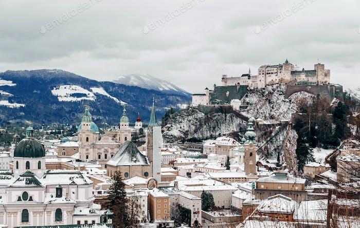 Cityscape of Salzburg, Austria. Snow, winter, moody sky.
