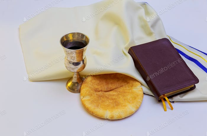 Chalice with red wine, bread and Holy Bible