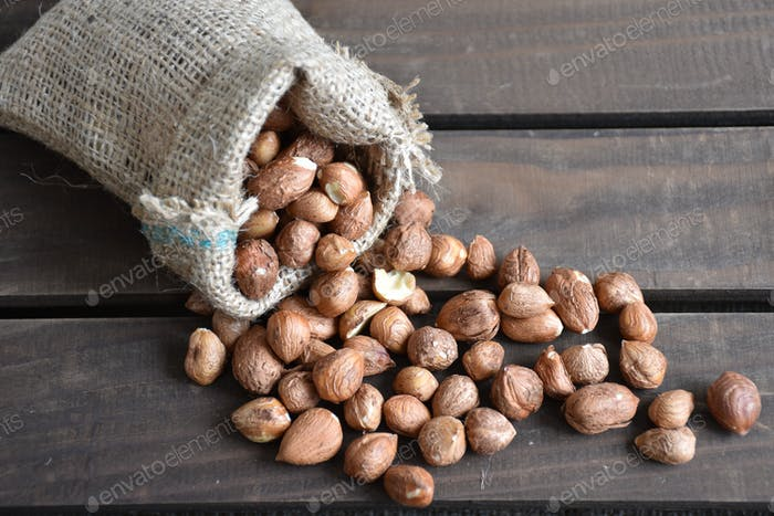 High angle view of hazel nuts on wooden table