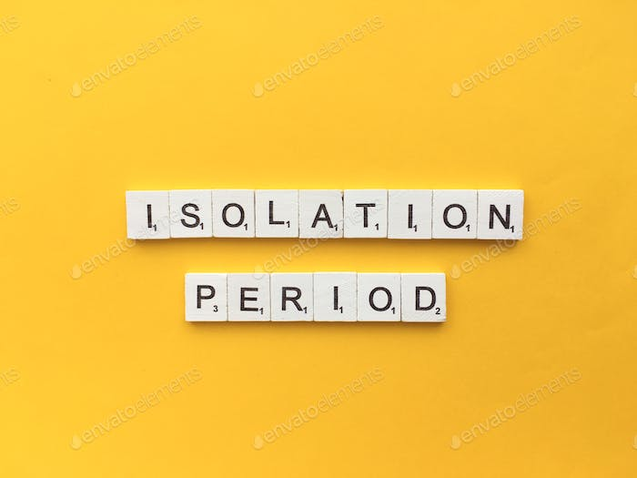 Isolation period scrabble letters word on a yellow background