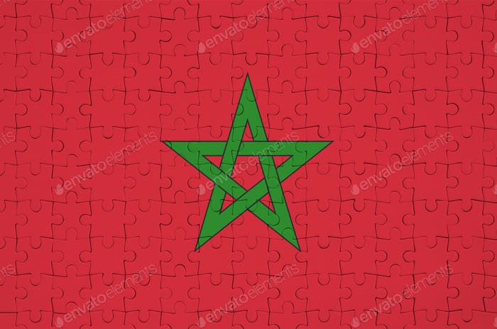 Morocco flag  is depicted on a folded puzzle