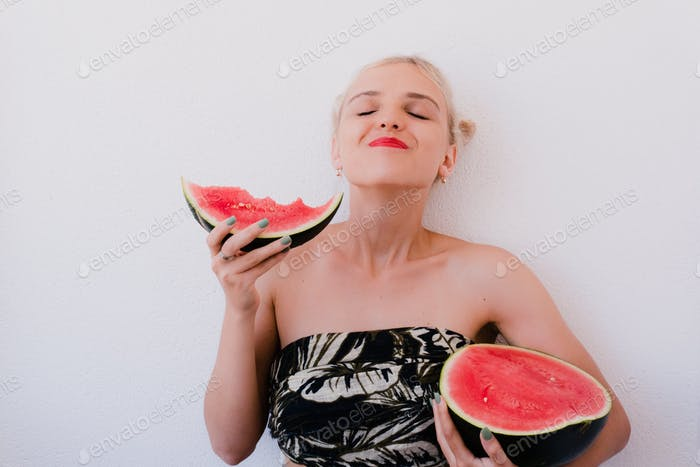 Girl with a red watermelon