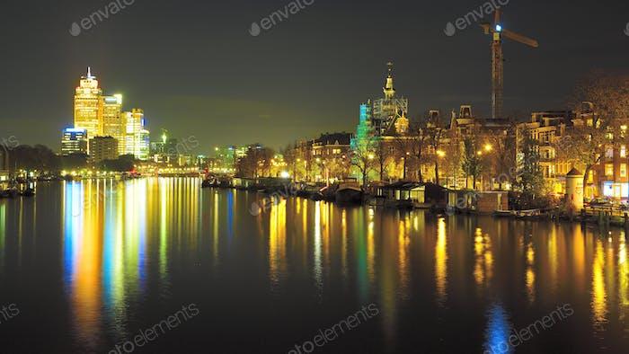 Amsterdam city canal water night