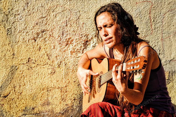 Gipsy woman plays the guitar
