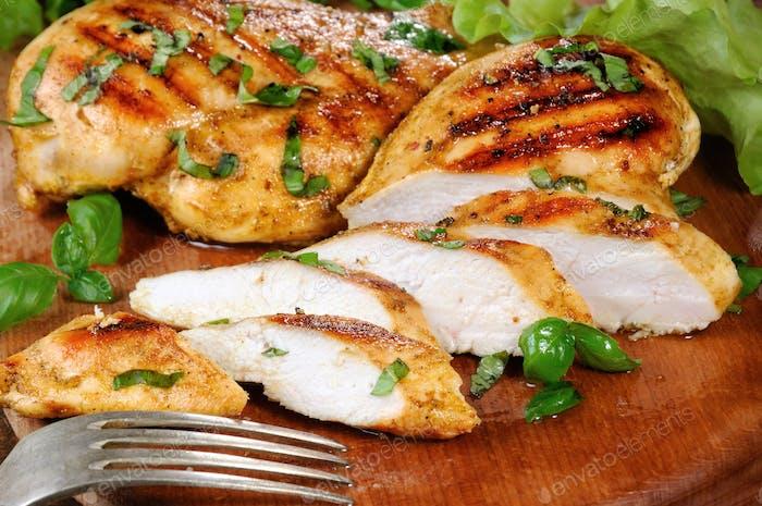 Sliced juicy, tender chicken breast grill close-up.