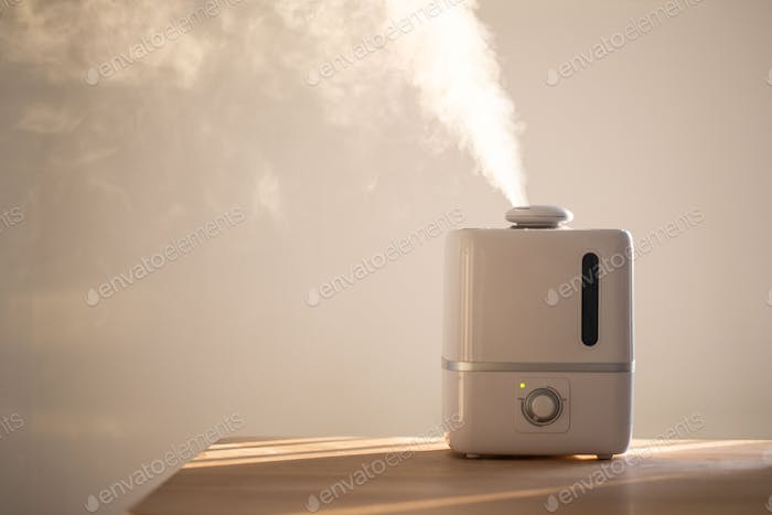 Air humidifier on the table at home during heating period to n winter season