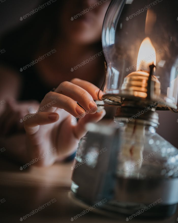 Girl lighting lamp