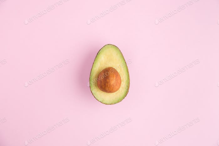 Isolated avocado half on a pink background. Perfect for Instagram!
