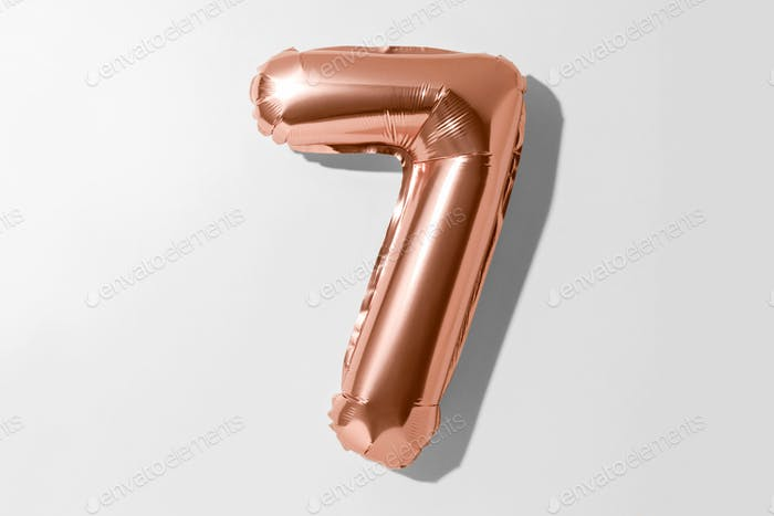 Number 7, Rose gold foil balloon number seven isolated on a white background with Clipping Path