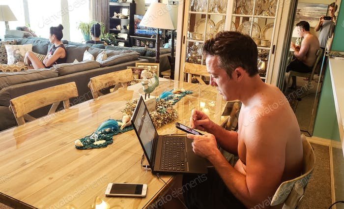 Generation X man checking his emails and computer as part of his morning routine waiting for me to
