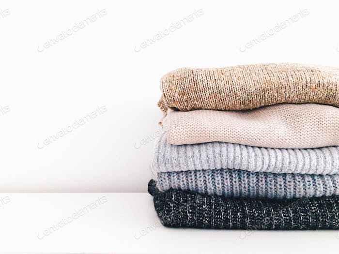 Stack of sweaters. Neatly folded