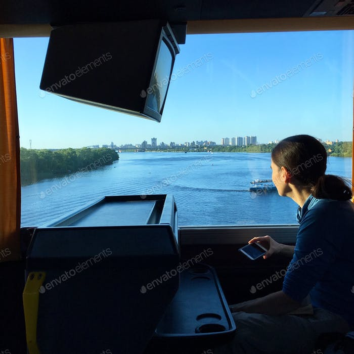 Travel by motorcoach over the Dnipro River, Ukraine.