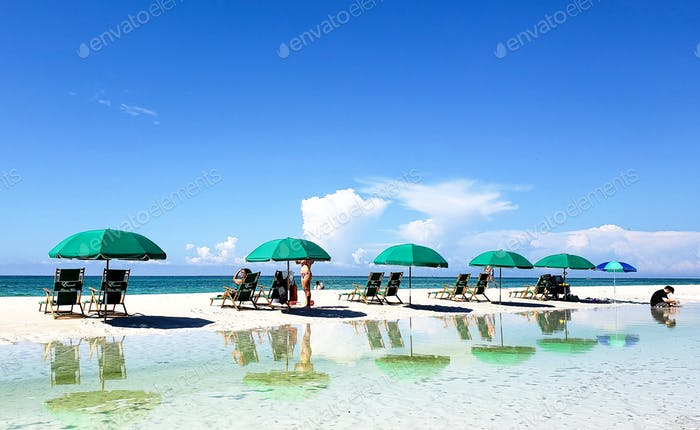 A day at the beach with reflections as well as natural light on a sunny day in the summer when