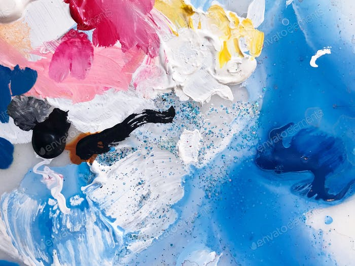 Bright and colorful abstract paint smears on artist's palette.